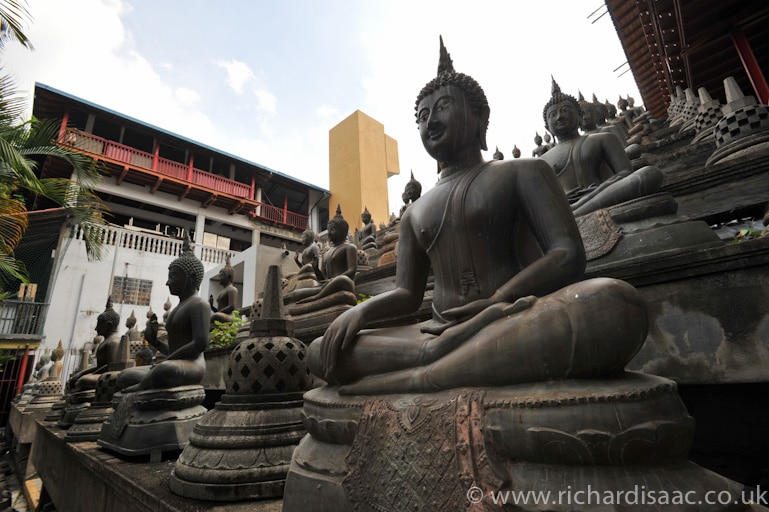 Statues of the Buddha at Gangaramaya Buddhist temple - Colombo, Sri Lanka