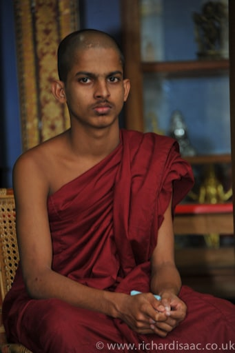 Buddhist monk at Gangaramaya Buddhist Temple - Colombo, Sri Lanka