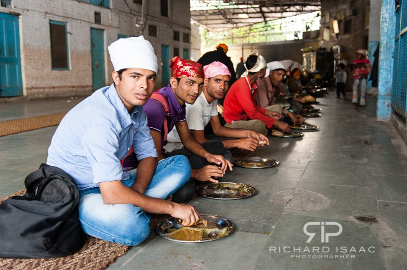 People about to eat in the Langer, at the Gurdwara Bangla Sahib Sikh Temple, Delhi – 12/11/12