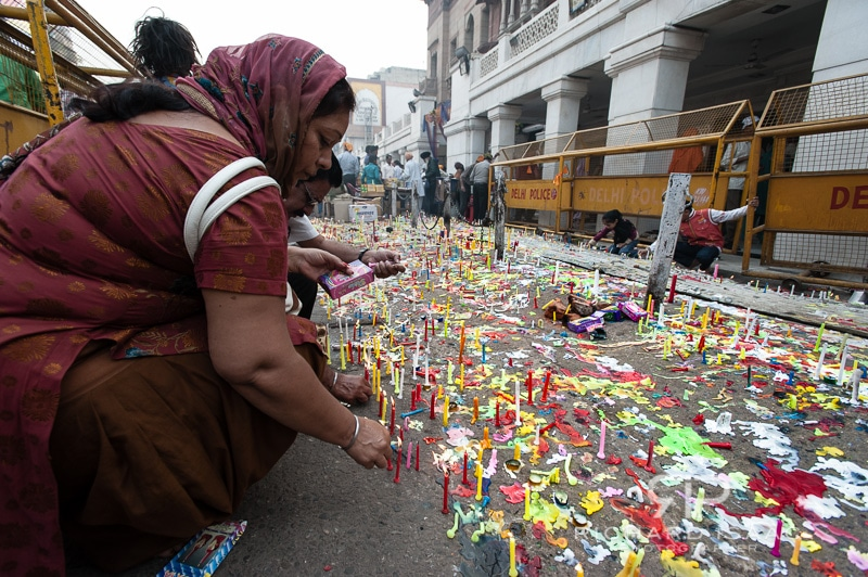 A woman lights a candle as part of Diwali celebrations, Delhi - 13/11/12