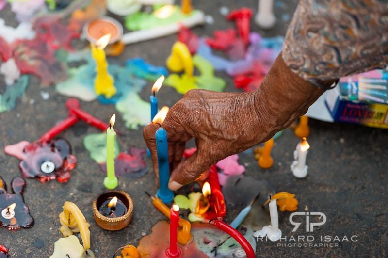 A woman lights a candle as part of Diwali celebrations, Delhi – 13/11/12