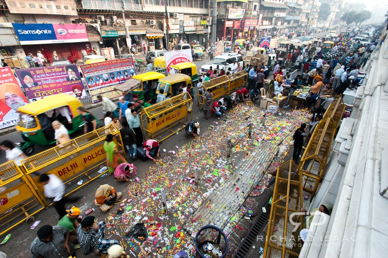 An area of road on the busy Chandni Chowk is barracaded off to allow people to light candles as they celebrate Diwali, Delhi - 13/11/12