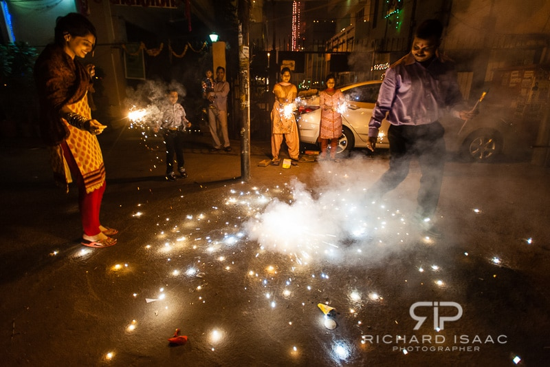 A family celebrates Diwali with fireworks outside their home - Delhi - 13/11/12
