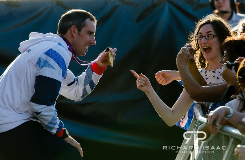 Team GB gold medal winning canoeist Etienne Stott shows his medal to an excited fan at BT London Live in Hyde Park - 3/8/12