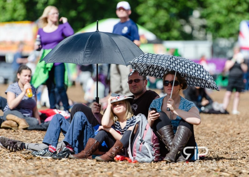 A family shelters from the hot sun whilst watching the Olympics on large screens at BT London Live Hyde Park - 5/8/13