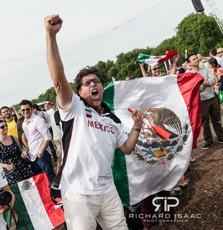 A Mexican football fan cheers his team as they triumph over Brazil in the London 2012 Olympic men's final - 11/8/12