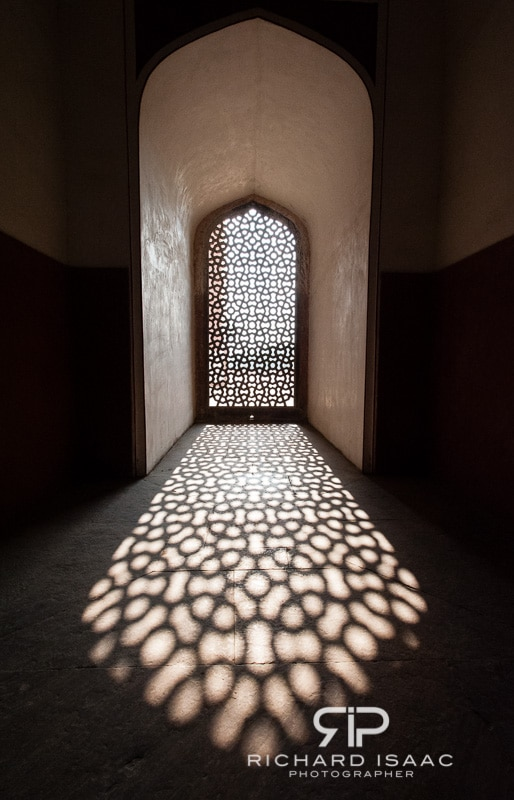 A latticed window casts a shadow at Humayun's Tomb in Delhi, India
