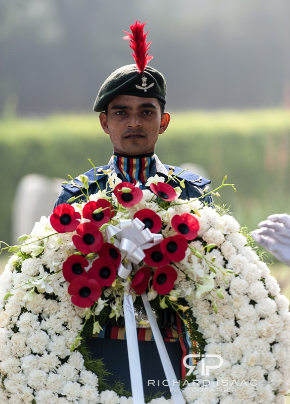 A member of the Indian Army holds a commemorative wreath at Delhi War Cemetery on Remembrance Day 2012 - India