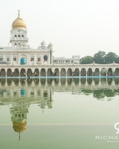 Delhi's Guardwara Bangla Sahib Sikh Temple is reflected in the lake before it - India