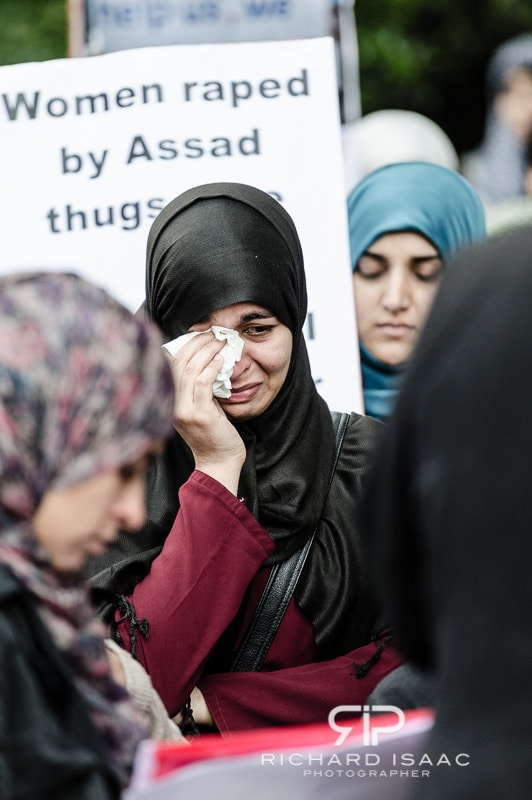 A muslim woman weeps at an anti-Assad protest outside the Syrian Embassy in London, held by the Muslim political group Hizb ut-Tahrir - 16/6/12