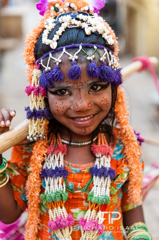 A young girl in decorative dress at Jaisalmer fort in Rajasthan, India