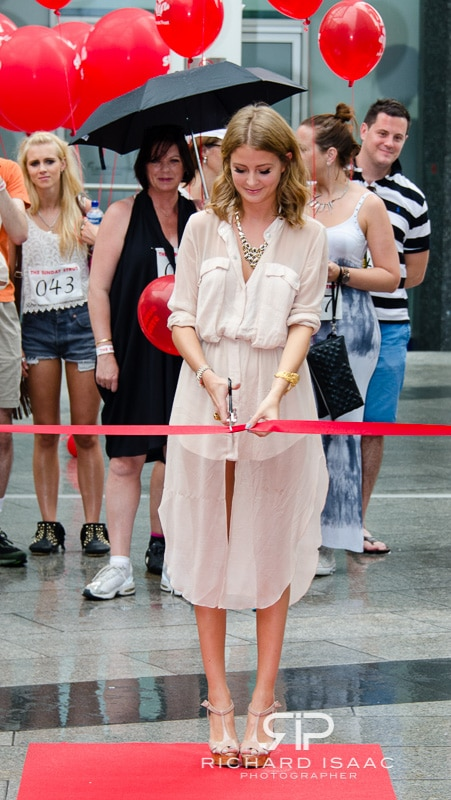 TV Celebrity Millie Mackintosh cuts the red ribbon to start the charity fund-raising walk the Sunday Strut in London, 19/8/12