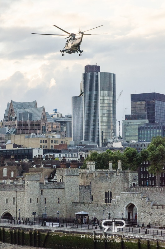 A Royal Marine Commando abseils down to the Tower of London carrying the Olympic Torch prior to the London 2012 Olympics - 20/7/12