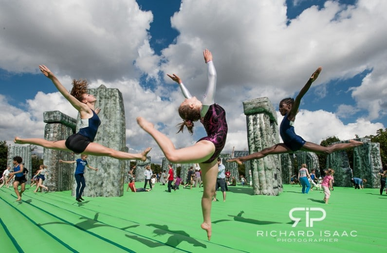 Children from Camden Gymnastics Club perform on the inflatable Stonehenge art installation by Turner Prize winning artist Jeremy Deller - 21/7/12