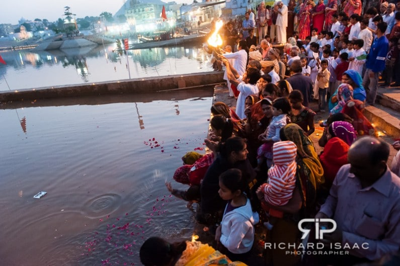 Holy men and pilgrims engaged in a religious ceremony at Pushkar ka mela, India