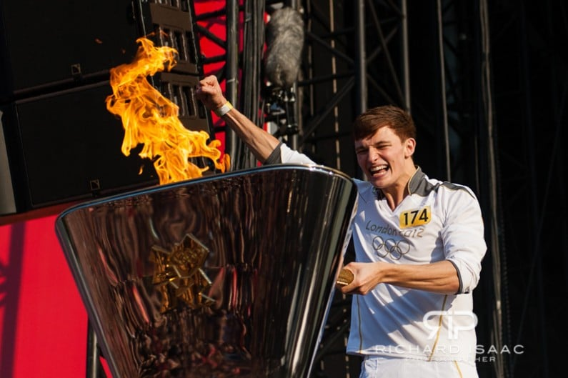 The London 2012 Olympics final torch bearer Tyler Rix lights the Olympic Flame in London's Hyde Park - 26/7/12