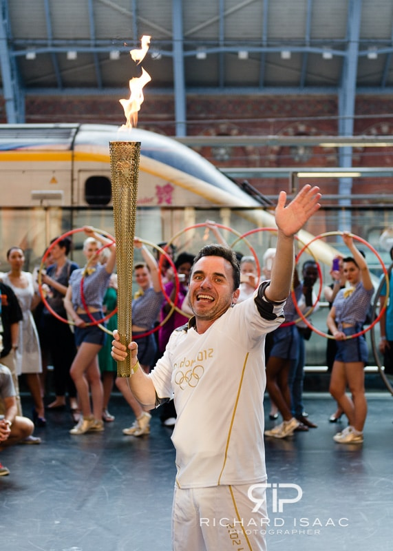 Olympic Torch Bearer Danny McCubbin proudly carries the torch prior the London 2012 Olympics, in St Pancras International Rail Station - 26/7/12